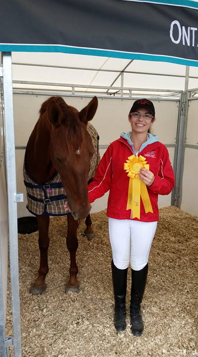 Jenna Mayhew and Kip celebrating their 4th place (out of 24 competitors) finish after their first Dressage Test at CIEC's!