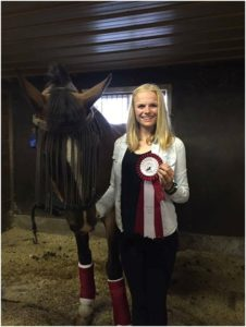 Emma Richardson & Sokit2ya with their First Place ribbon from the Pre-Training Junior division.