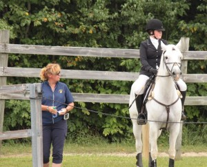 Coach Ruth Allum waiting with Alexa Bresnahan and Aragon at Harmony HT.