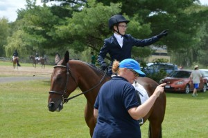 Coach Helen Richardson and Taya Davison on Nike going over her dressage test before Taya goes in the ring at Harmony HT.
