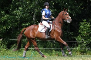 Kristin McLaren and her little red mare Panamerra on the Cross Country course at Harmony HT.
