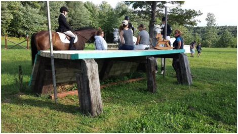 The Oakhurst Team discussing show jump at Robinson Horse Trials. Photo by: Janet van Weringh