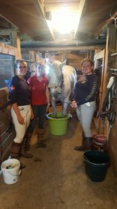 Chelsea Arden, Laura Gravelle & Alexa Bresnahan helpng the ponies cool their heels after brilliant XC rides at Robinson HT. Photo by: Ruth Allum