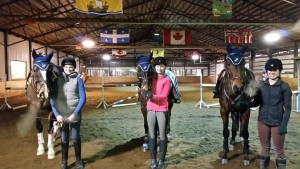 This lesson group came prepared - wearing matching Oakhurst bonnets on their horses! Left to right: Emma & Sokit2ya, Kenzi & Top Gun and Kieryn & King Stag.