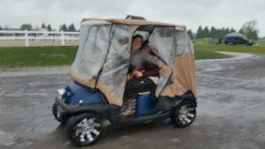 The golf cart even came prepared for the rain. Miranda Lepore and Kristin McLaren kept dry inside!