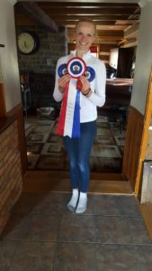 Emma Richardson showing off the ribbons she and Sokit2ya (Sox) won at the Dewmont Silver Dressage Show.