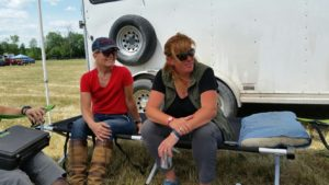 Cindy Moore & Coach Ruth Allum sharing the cot during the impromptu team meeting under the tent at Dewmont Silver Dressage Show.