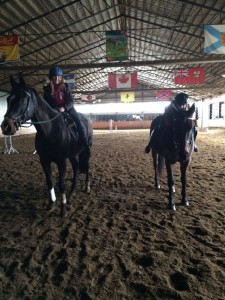 Angelina and Alissia taking part in No Stirrups November in their Saturday morning lesson.