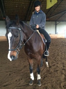 Hannah Ledgerwood practicing riding with the Equicube in her lesson.